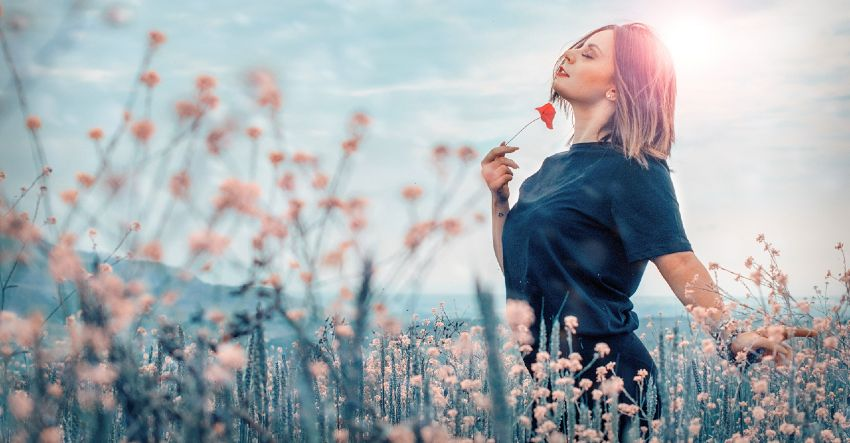 Woman in a Field Enjoying the Benefits of EFT Tapping / Emotional Freedom